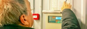 Worker Maintaining Commercial Fire Alarm System